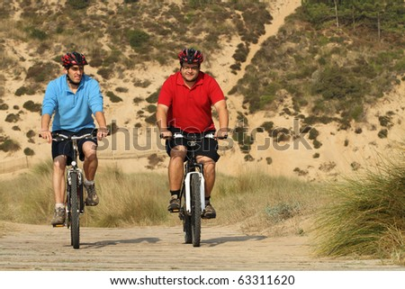 biker in action with a beautiful landscape - stock photo