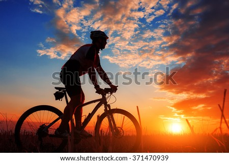 biker in autumn on a sunny afternoon - stock photo