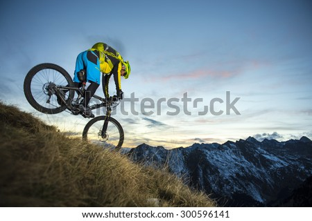 Biker in evening mood in the highest action