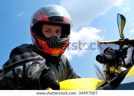 Biker in helmet portrait - stock photo