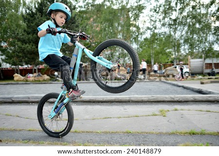 Biker jumping - stock photo