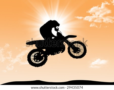 Biker jumping and have fun in a wonderful sunny day