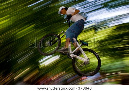 biker jumping in the air - stock photo