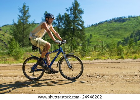 Biker on rural mountain road