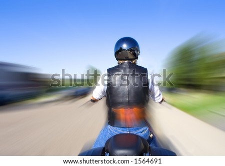 Biker riding his motorcycle