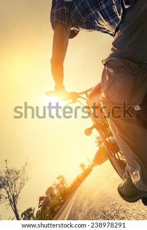 Biker riding on the motorcycle on asphalt road - stock photo