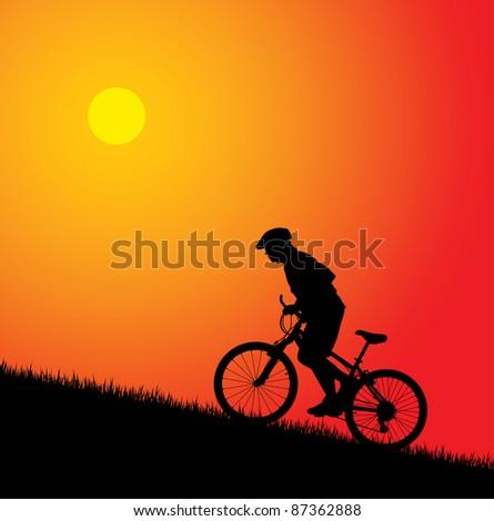 Biker silhouette on the sunset - stock photo