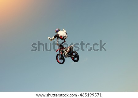 Biker stuntman doing a stunt in the air