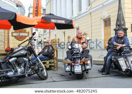 Bikers from Germany at the motorcycle. St. Petersburg, Russia - 12 August, 2016. The annual International Festival of Motor Harley Davidson in St. Petersburg Ostrovsky Square.