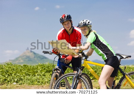 bikers holding a map, Hazmburk, Ceske stredohori, Czech Republic - stock photo