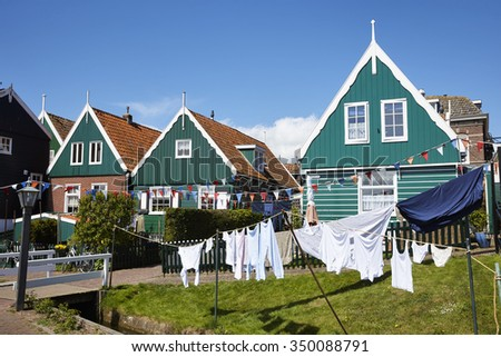 Bikers on rental bikes going to the town of Marken, that used to be an iisland in the former Zuiderzee (Southern Sea), the Netherlands - stock photo