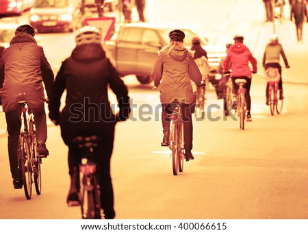 Bikes and bicyclist in traffic - stock photo