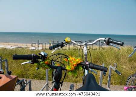 Bikes at the summer beach with sea in the background, blurred selective focus