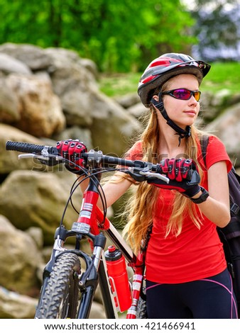 Bikes bicyclist girl. Girl rides bicycle into mountains. Girl on bicycle in mountaineering  . Mountaineering  is good for health. Cyclist looking away. - stock photo