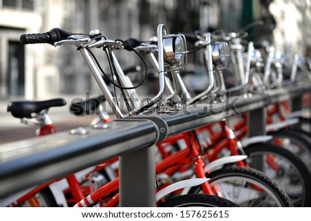 Bikes for rent are seen in a velo station  - stock photo