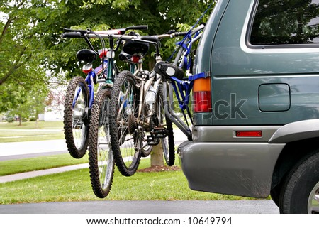 Bikes Loaded on the Back of a Van - stock photo