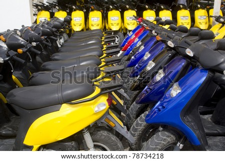 bikes motorbikes motorcycles rows in a renting shop - stock photo