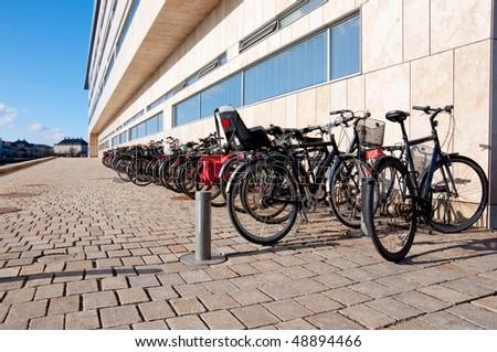 Bikes near the Opera building in Copenhagen - stock photo