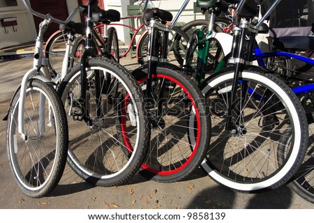 Bikes parked and lined up in a row - stock photo
