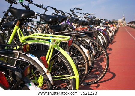 bikes parked in the center of amsterdam, high contrast, focus on yellow bike - stock photo