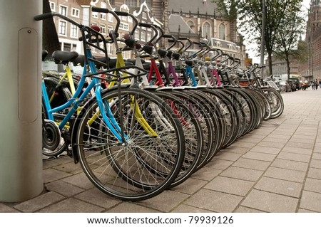 Bikes parked in the city Amsterdam, Netherlands - stock photo