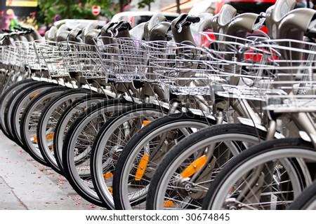 Bikes parking in a Paris street - stock photo