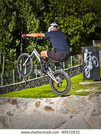 Biketrial jump - stock photo