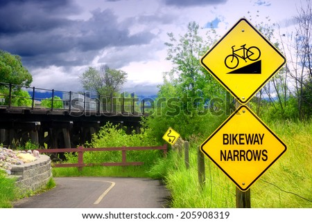 Bikeway narrows sign on bike path in Kalispell, Montana - stock photo