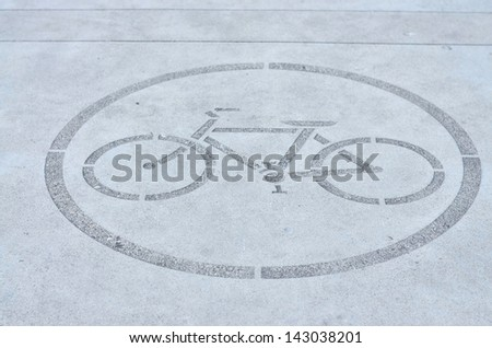 Biking allowed sign on the ground - stock photo