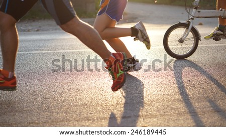 biking and running abstract in the morning sun - stock photo