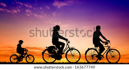 Biking family at sunset