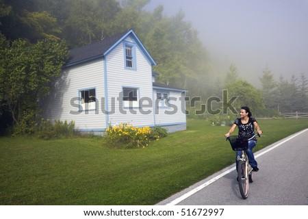 Biking in fog - Mackinac Island, Michigan, USA. - stock photo