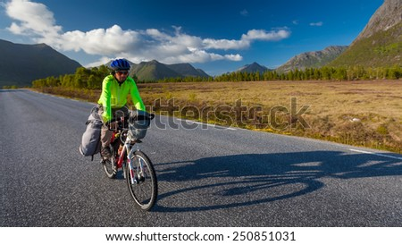 Biking in Norway against picturesque landscape - stock photo