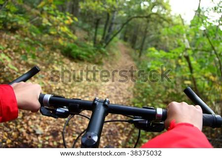 Biking. Mountain bike in the autumn forest. - stock photo