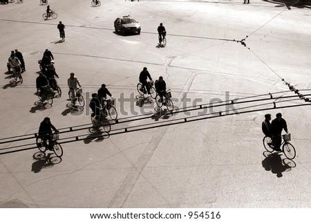 biking  on a street in bejing china - stock photo