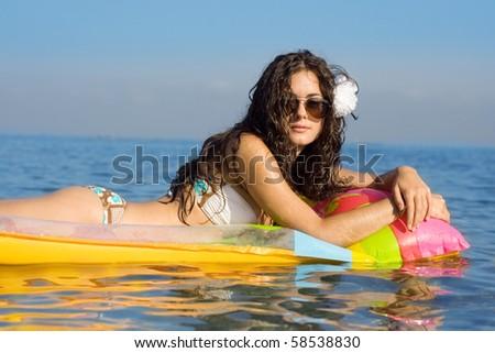 Bikini girl with inflatable - stock photo