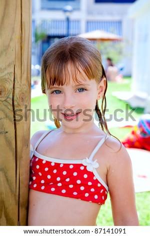 bikini kid girl water wet in pool garden holding sunroof pole - stock photo