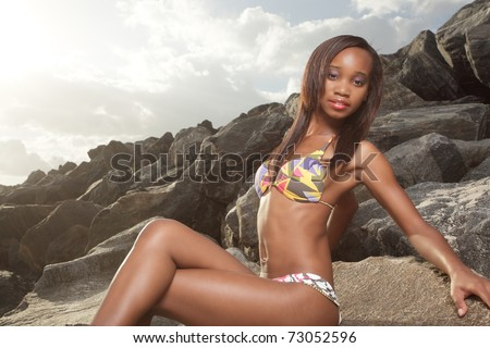 African American Woman With Legs Crossed Stock Images