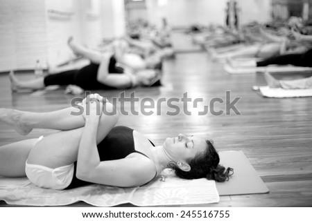 Bikram yoga hand and wrist  stretching exercises   - stock photo