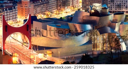 BILBAO, SPAIN - AUGUST 9: Exterior view of the Guggenheim Museum at sunset on Bilbao, Spain. 2013.This Museum is dedicated exhibition of modern art. - stock photo