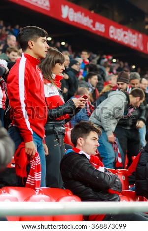 BILBAO, SPAIN - JANUARY 20: Unidentified woman and men Athletic Club Bilbao fans in the quarter-finals of the Cup match between Athletic Club Bilbao, celebrated on January 20, 2016, in Bilbao, Spain - stock photo