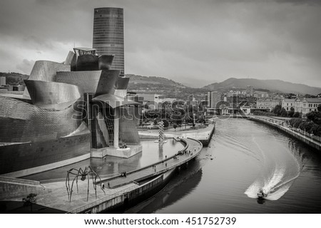 BILBAO, SPAIN - June 18, 2016: Guggenheim Museum on June 18, 2016 in Bilbao, Spain. This and futuristic museum was designed by Frank Gehry. - stock photo