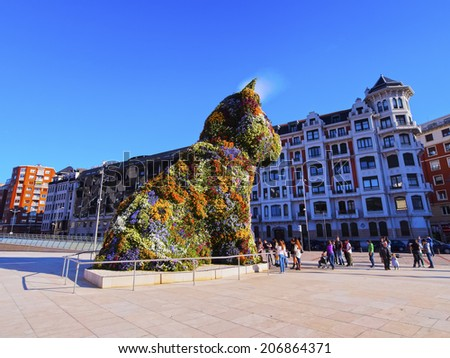 BILBAO, SPAIN - MARCH 9, 2013: The giant floral sculpture 'Puppy' - the dog is a work of Jeff Koons placed in front of The Guggenheim Museum in Bilbao, Biscay, Basque Country, Spain