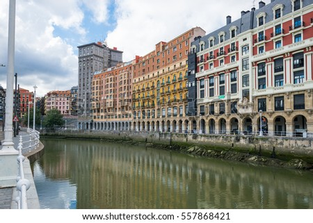 BILBAO, SPAIN - OCTOBER 06. Houses in Bilbao along the Nervion river that runs through the city. The buildings are situated in the districts San Frantzisko and Bilbao la Vieja in October 06, 2016