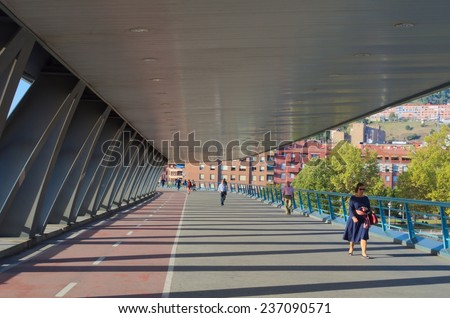 BILBAO, SPAIN, OCTOBER 27, 2014: People are crossing covered bridge in spanish city bilbao.