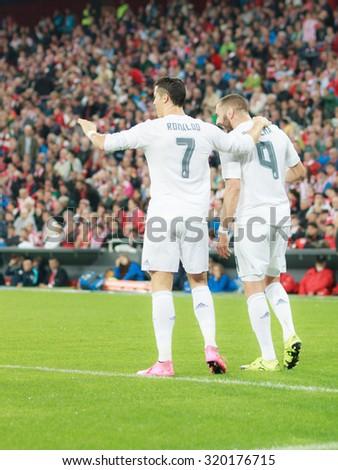BILBAO, SPAIN - SEPTEMBER 23: Karim Benzema and Cristiano Ronaldo are celebrating a goal in the San Mames Stadium, on September 23, 2015 in Bilbao, Spain - stock photo