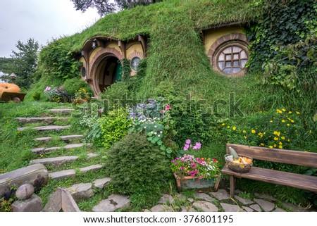 bilbo baggins home and hobbit garden in hobbiton movie set, new zealand. Taken during summer. - stock photo