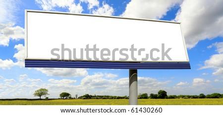 Bilboard on blue sky - stock photo