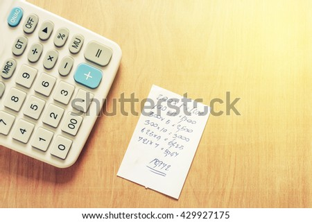 Bill and calculator on wooden, Macro paper bill and calculator on wooden texture, Bill for income and expenditure with copy space, Vintage style - stock photo