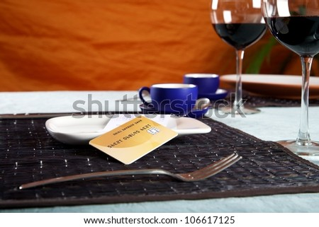 bill and credit card on white plate at restaurant - stock photo